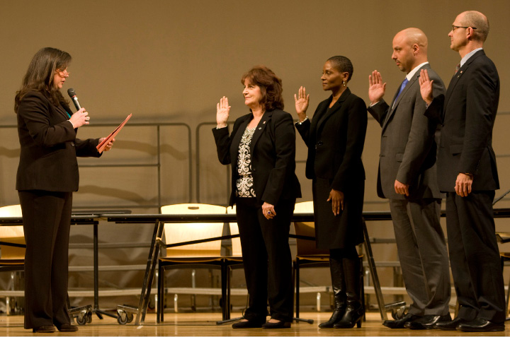 City Council members, left to right, Catherine R. Battista, Sonya R. Jelks, Michael P. Cardona III and Brian P. Daniels are sworn in by State Senator Danté Bartolomeo, left, during inauguration ceremonies at Lincoln Middle School in Meriden, Monday, Dec. 7, 2015.  |  Dave Zajac / Record-Journal