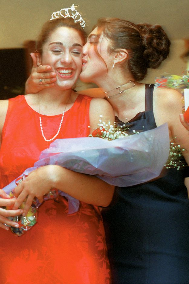 RJ file photo -Apple Harvest Festival Queen Suzanne Mobarak, left, gets a kiss from runner-up Stephanie Moffo, Oct. 2, 1998.