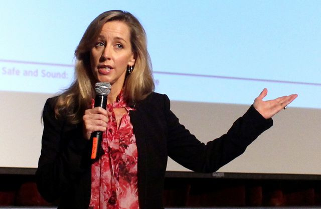 In this Oct. 10, 2017 photo, Michele Gay speaks to educators at the Groton Dunstable Regional Middle School in Groton, Mass., as part of her Safe and Sound Schools initiative. Gay began advocating for school safety after her daughter, Josephine, was killed in the Sandy Hook Elementary School shooting five years ago. (AP Photo/Pat Eaton-Robb)