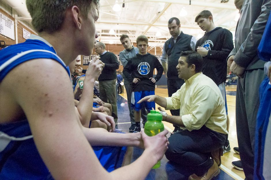Southington boys basketball coach John Cessario talks with his players during their Jan. 22 game at Platt. The 69-43 victory the Blue Knights posted that night was the second in the current six-game winning streak they take into today's Senior Night game at home against Hall. Southington stands at 10-6.