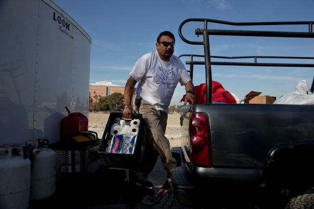 "Armando Olvera, 49, who has been providing mobile showers for the homeless since 2010, gives out rolls of toilet paper to homeless people while operating a shower trailer on the Santa Ana River trail Saturday, Dec. 2, 2017, in Anaheim, Calif. ""How long I can do this? Forever,"" said Olvera whose day job is a plumber. Goodhearted neighbors heartbroken over the rising number of homeless in their communities are dishing out hot meals, providing mobile showers and handing out sandwiches to..."