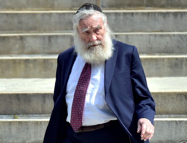FILE - In this Monday, Aug. 14, 2017, file photo, Rabbi Daniel Greer, of New Haven, leaves New Haven Superior Court after he was arraigned, in New Haven, Conn. Greer is scheduled to be sentenced Wednesday, Nov. 20, 2019, in New Haven Superior Court, where a jury convicted him in September of four counts of risk of injury to a minor. Each count carries up to 20 years in prison. (Peter Hvizdak/New Haven Register via AP, File)