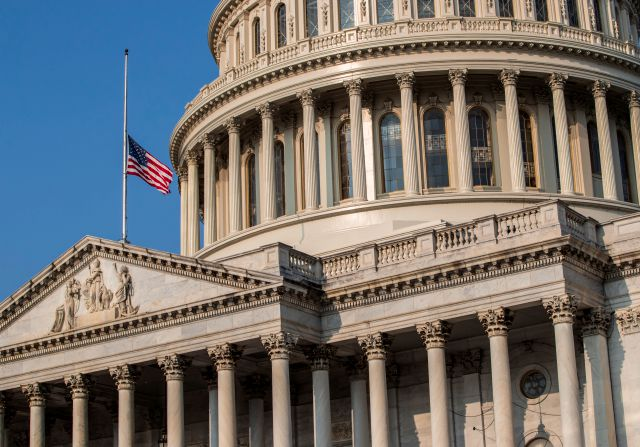 The American flag flies at half-staff at the Capitol in honor of Sen. John McCain of Arizona who died Saturday of brain cancer, in Washington, Monday, Aug. 27, 2018. McCain will lie in state in the Capitol Rotunda on Friday. (AP Photo/J. Scott Applewhite)