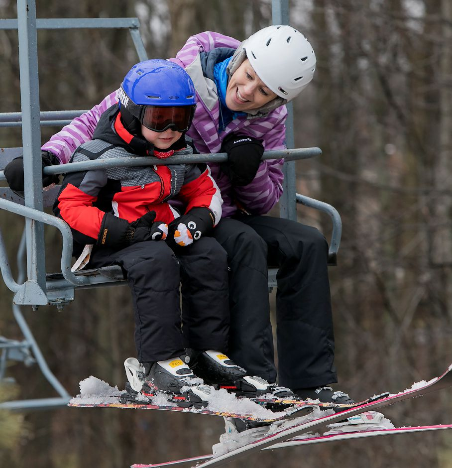 Peter Dean, 5, of Simsbury, rides the chairlift with instructor, Casey Kaiser, of Plainville, during the Connecticut Children