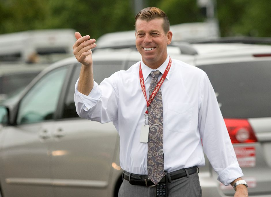 Principal Frank Pepe directs parents dropping off students during the first day of school at DePaolo Middle School in Southington, Thursday morning, September 1, 2016. | Dave Zajac, Record-Journal