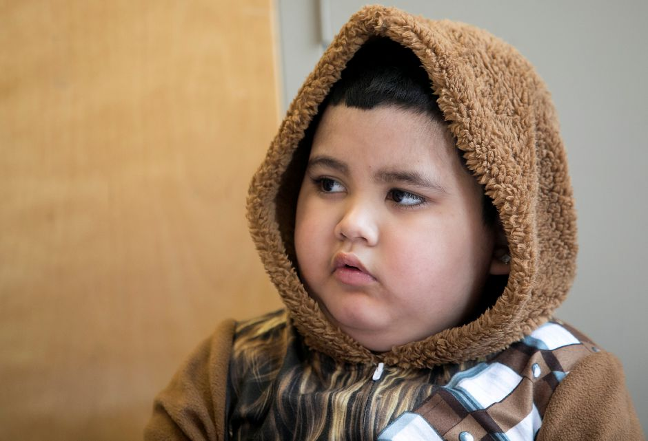 First-grade student Ethan Heng, 6, wears Chewbacca pajamas while visiting a kindergarten class during Pajama Day at Israel Putnam Elementary School in Meriden, Friday, Dec. 8, 2017. Dressed in pajamas, students and teachers took time from their lessons to make cards and activity books for children with cancer including Ethan, a classmate diagnosed with brain cancer. Dave Zajac, Record-Journal