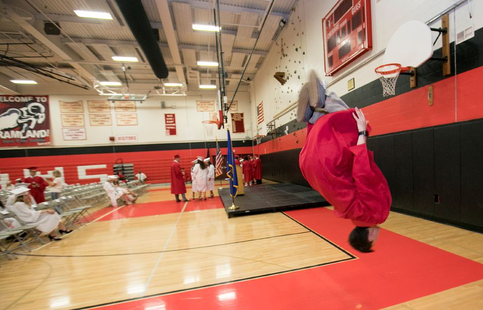 Graduate Jack Donahue, 18, performs a backflip before the start of graduation ceremonies at Cheshire High School, Thursday, June 21, 2018. Dave Zajac, Record-Journal