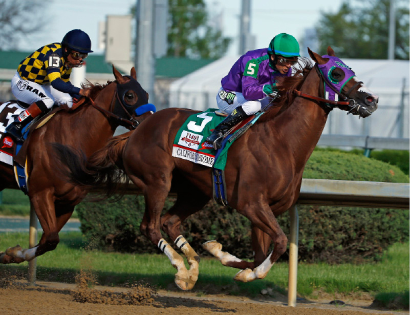Victor Espinoza rides California Chrome to a victory during the 140th running of the Kentucky Derby horse race at Churchill Downs Saturday, May 3, 2014, in Louisville, Ky. (AP Photo/Matt Slocum)