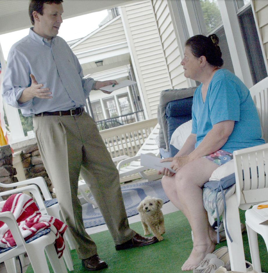 MERIDEN, Connecticut - Tuesday, August 7, 2007 - Rep. Chris Murphy talks with Mary Shatas on her front porch Tuesday afternoon on North Pearl St. Her poodle Muffin 4, was happy to have a visitor stop by. Rob Beecher / Record-Journal