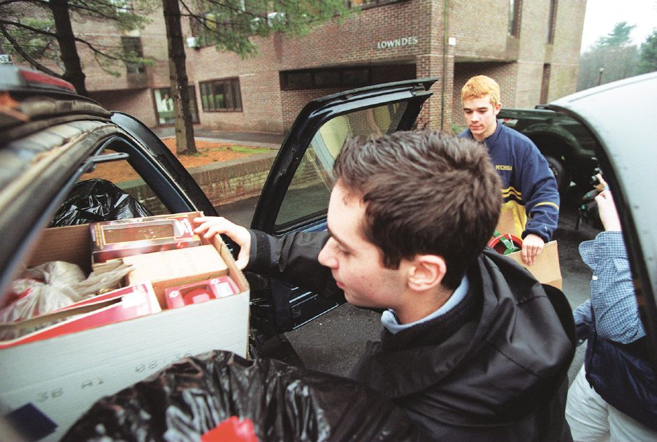 RJ file photo - Aaron Painter, 17, of Briarcliff Manor, N.Y. a junior at Choate Rosemary Hall, loads Christmas decorations into a van en route to the Curtis Home in Meriden, assisted by Patrick Axmayer, 14, of Wallinford, a freshman, and Kate Bechtel, 17, of Old Lyme, a senior, Dec. 17, 1998.