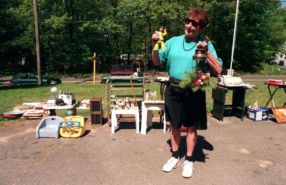 RJ file photo - Marge Kania of Plantsville with a few items from a tag sale she recently hand, May 1999.