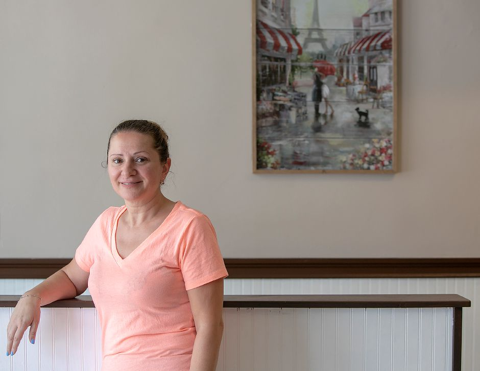 Kuitima Dalipovski, of Waterbury, who will be opening Downtown Coffee Shop in the former Cafe Dolce space at 33 W. Main St. in Meriden, stands in the restaurant Thursday. It is currently under renovation and will open Monday. Dave Zajac, Record-Journal