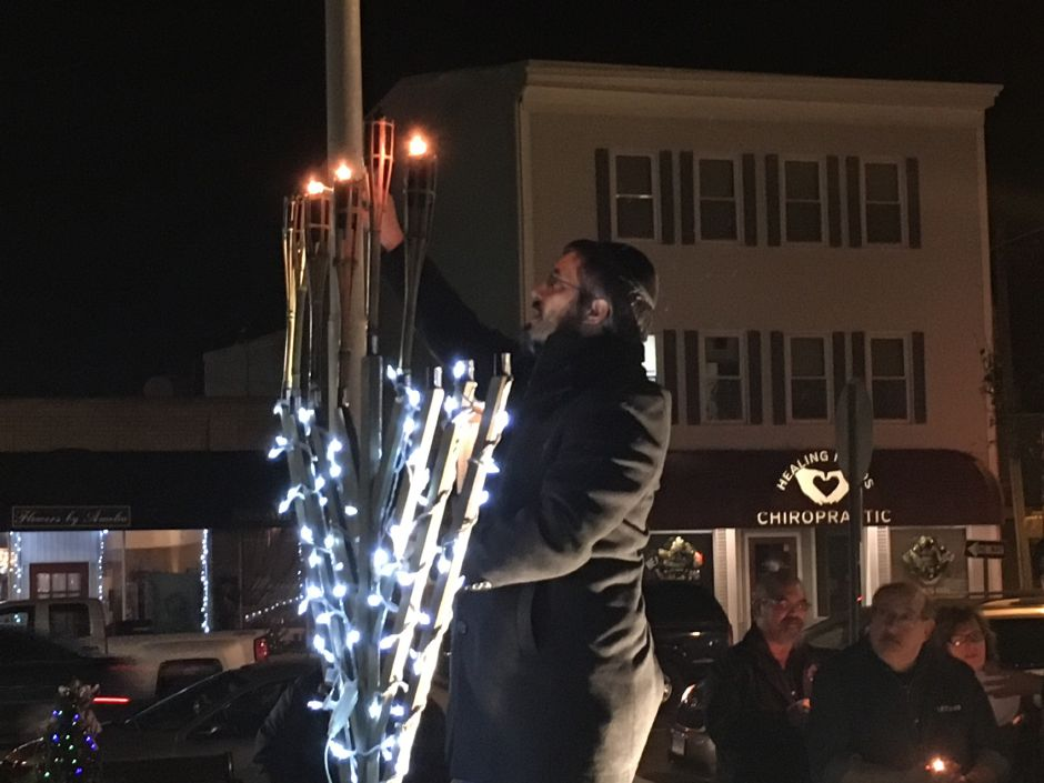 Rabbi Kaplan completes the lighting of five candles for the fifth night of Hanukkah at the 14th annual public lighting.