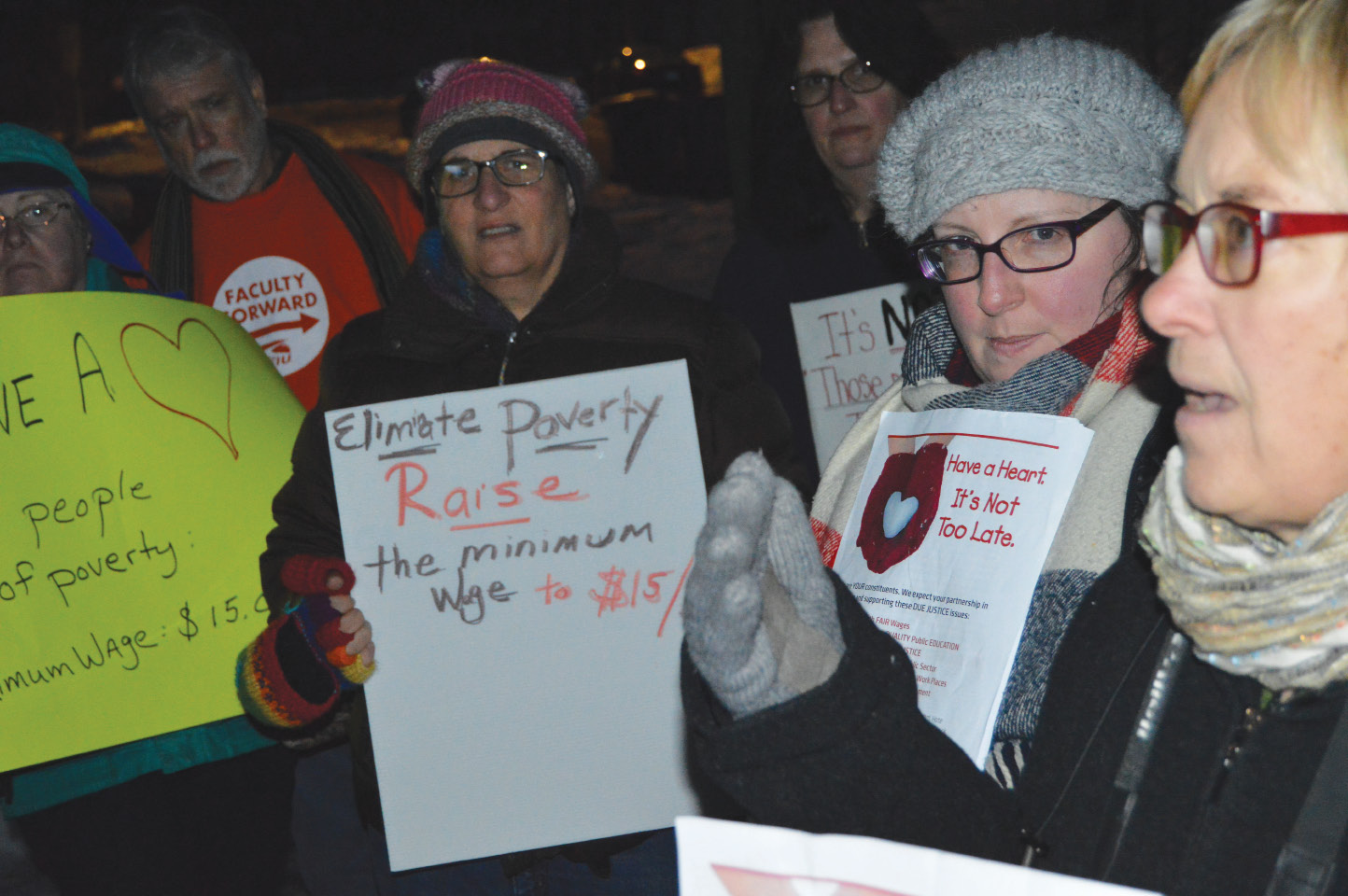 About a dozen area residents demonstrated outside the home of Sen. Len Suzio in Meriden on Wednesday. Groups gathered for similar demonstrations, organized by the DUE Justice Coalition, outside the homes of senators around the state.| Mike Savino, Record-Journal