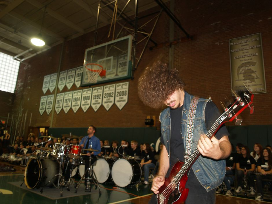 Junior Zach Fontanez plays bass guitar during a pep rally at Maloney High School Wednesday morning, November 23, 2011. (Richie Rathsack / Record-Journal)