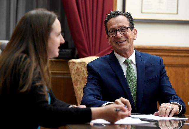 Connecticut Gov. Dannel P. Malloy works on his final closing speech at the end of session with Communications Director Kelly Donnelly, left, in his office the at the State Capitol, Wednesday, May 9, 2018, in Hartford, Conn. (AP Photo/Jessica Hill)