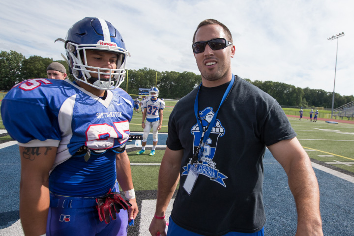 Southington head coach Mike Drury talks with senior captain Ryan Montalvo  during practice at Fontana Field. A two-way standout as a sophomore, Montalvo lost most of his junior season to injury. This year, he