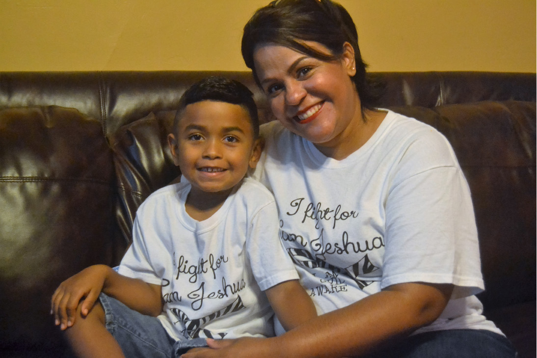 Jeshua Lopez, 6, and his mother Jessica Lopez pose at their house. The Lopez