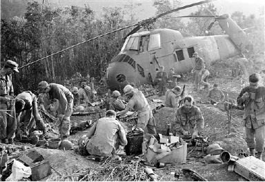 FILE - In this Sept. 21, 1966 file photo, U.S. Marines emerge from their muddy foxholes at sunrise after a third night of fighting against continued attacks of north Vietnamese 324 B division troops during the Vietnam War. The war ended on April 30, 1975, with the fall of Saigon, now known as Ho Chi Minh City, to communist troops from the north. (AP Photo/Henri Huet, File)