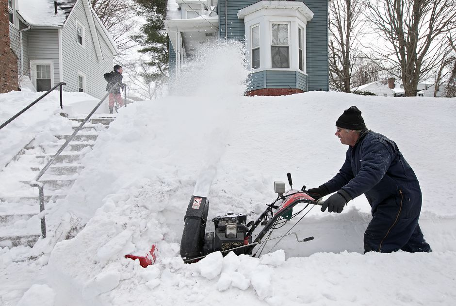 Clifford Bacon, of Meriden, uses a snow blower to clear heavy snow from the walk of his residence on New Hanover Avenue in Meriden, Wednesday, March 15, 2017. | Dave Zajac, Record-Journal