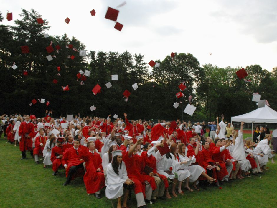 CHESHIRE, Connecticut - Wednesday, June 18, 2008 - Mortarboards fly at the conclusion of the 54th year of Commencement Exercises at Cheshire High School on Wednesday, June 18, 2008. Rob Beecher / Record-Journal