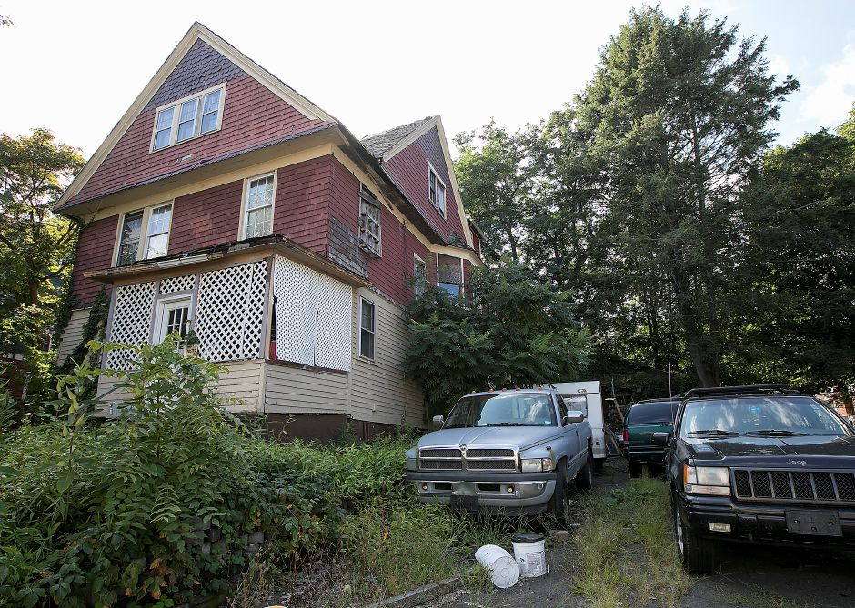 A blighted property at 11 Colony Pl in Meriden, Wednesday, August 30, 2017. | Dave Zajac, Record-Journal
