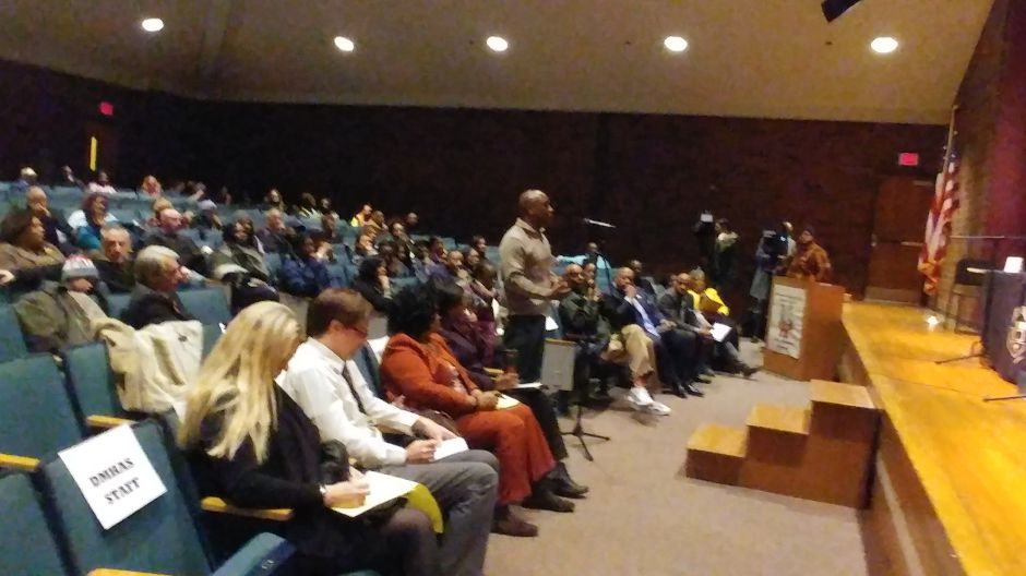 An employee of the state Department of Mental Health and Addiction Services testifies about discrimination at a Commission on Human Rights and Opportunities Forum Thursday at Washington Middle School.