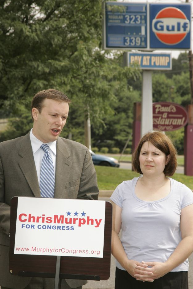 State Sen. Chris Murphy, with Cheshire resident Jean Garner, unveiling his energy plan outside of a Gulf station on Highland Ave. in Cheshire Wed. morning, July 19. He is running against Nancy Johnson for Congress.
