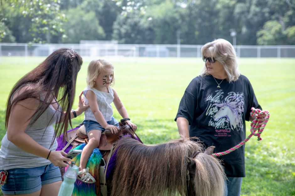 Briannah Macinnis, 4, rides one of the two ponies at Plainville