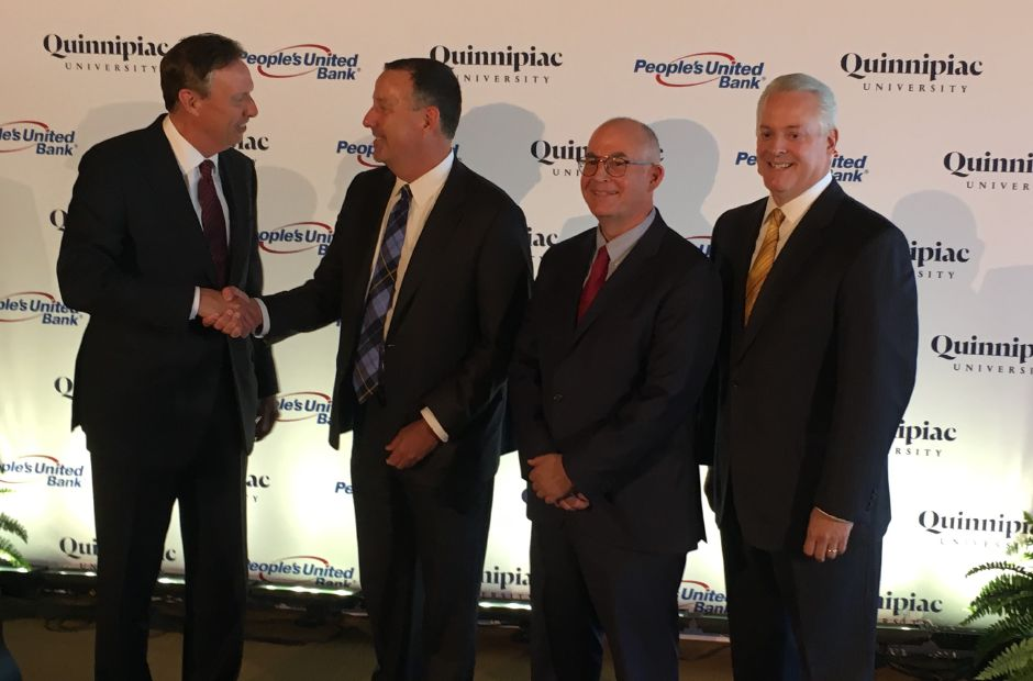 Quinnipiac University announced a $10 million partnership with People's United Bank during a joint press conference on Thursday, May 24, 2018. From left: Quinnipiac University President John Lahey, President of People's United Bank Jeff Tengel, Dean of the School of Business Matt O'Connor and Director of Athletics Greg Amodio. | Lauren Takores, Record-Journal