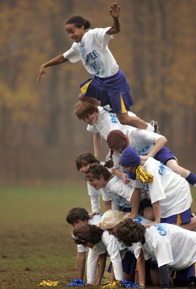 Cheerleader Jason Ruiz struggles at the top of a pyramid during halftime of the first powder puff game at Wilcox Tech in Meriden November 20, 2007. Wilcox and St. Paul tied 18-18 in the contest. (dave zajac photo)