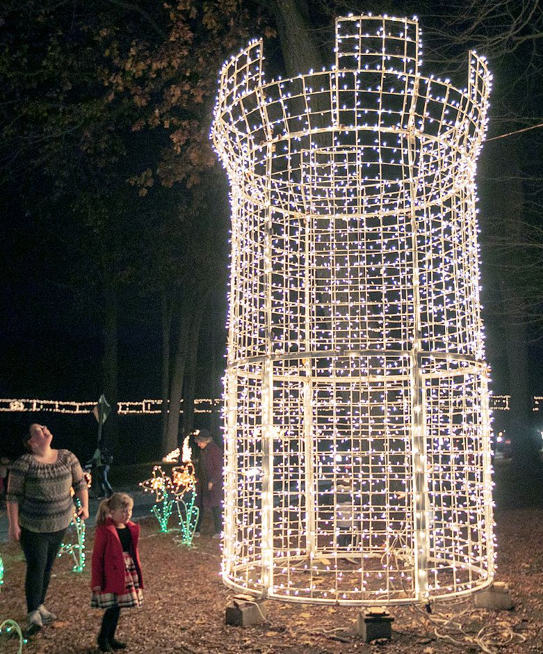 Lisa Delbuco and daughter Lily, 5, of Wallingford, look over the Castle Craig lighted display during the annual Festival of Silver Lights at Hubbard Park in Meriden, Tues., Nov. 26, 2019. Dave Zajac, Record-Journal