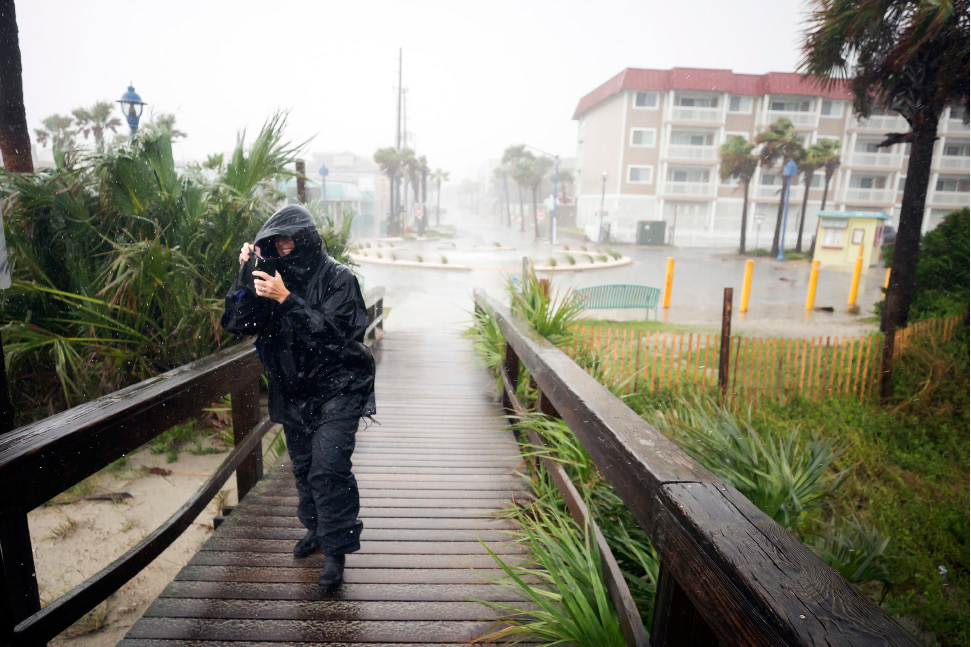 Bethany Kellam walks onto the southend beach of Tybee Island, Ga., Monday, Sept., 11, 2017. The National Weather Service placed most of Georgia under a tropical storm warning. (AP Photo/Stephen B. Morton)