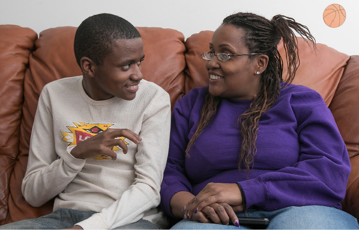 Sandra Jackson, of Meriden, talks with her autistic son, Shunnar, 16, at their home on Friday. Shunnar has trouble communicating and suffers from seizures, headaches and gastrointestinal issues, among other health problems.  | Dave Zajac, Record-Journal