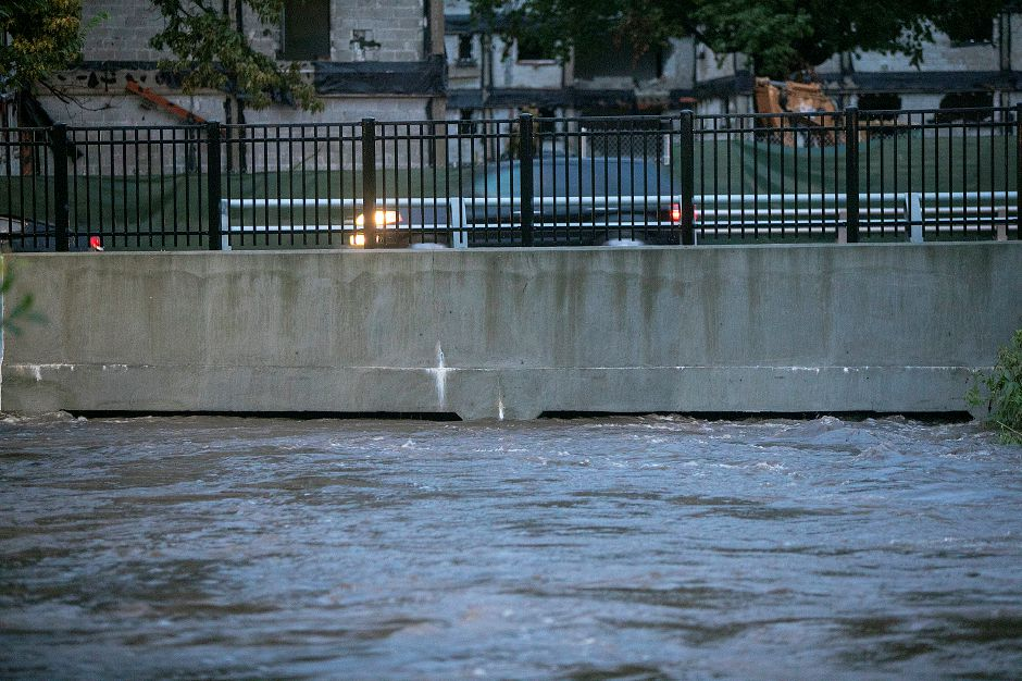 Harbor Brook rises to the top of culverts leading into the Meriden Green from Mill Street, Tuesday, Sept. 25, 2018. Heavy rain Tuesday evening closed roads and flooded basements of local homes. Dave Zajac, Record-Journal
