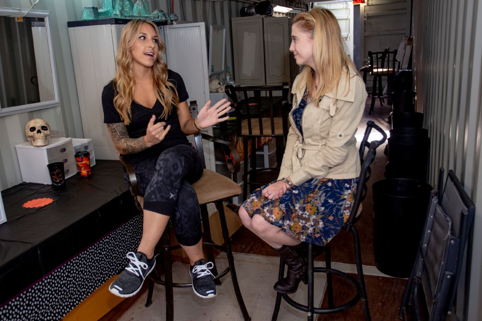 Makeup artist Christina Klanchich talks with Record-Journal Digital Content Producer Ashley Kus at the Haunted Graveyard at Lake Compounce Sept. 27, 2018. | Richie Rathsack, Record-Journal