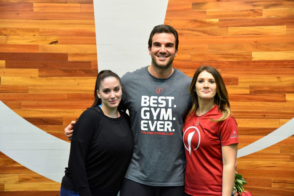 "Former ""The Bachelorette"" contestant and Meriden resident Matt Munson poses with sweepstakes winner Noel Tufano and The Edge trainer Lindsay Boyles at the gym on Tuesday, Feb. 13, 2018. 