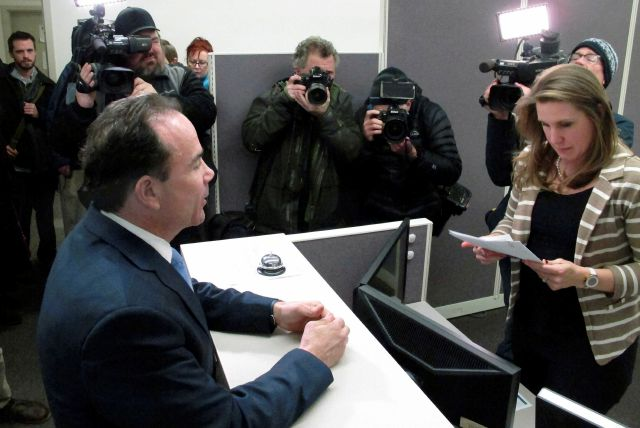 Bridgeport, Conn., Mayor Joe Ganim, left, files papers to run for Connecticut governor in Hartford, Conn., on Wednesday, Jan. 3, 2018. He is speaking with state elections officer Sarah Clark, right, at the State Elections Enforcement Commission Office. Ganim was elected Bridgeport mayor in 2015 after serving nearly seven years in prison for corruption committed during a previous term as mayor. (AP Photo/Dave Collins)