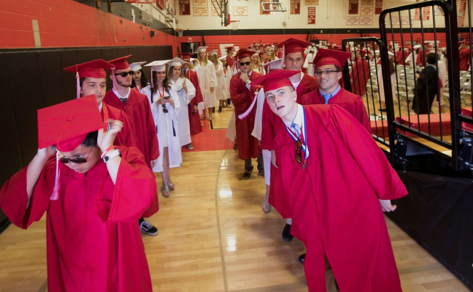 Graduates prepare for the procession to graduation ceremonies at Cheshire High School, Wednesday, June 14, 2017. | Dave Zajac, Record-Journal