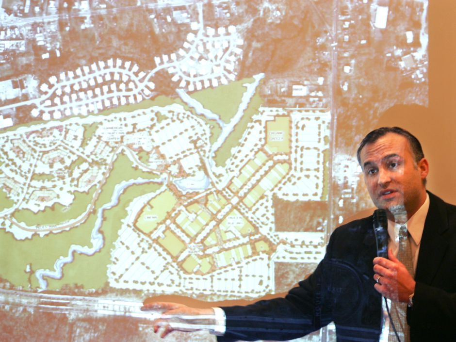 Louis Masiello, director of development with W/S Development Associates LLC, uses a projection image to describe plans of a proposed shopping area in Cheshire. This is at a North End Development information meeting held at the Connecticut Grand Hotel in Waterbury Tuesday morning February 13, 2007. Chris Angileri/Record-Journal.