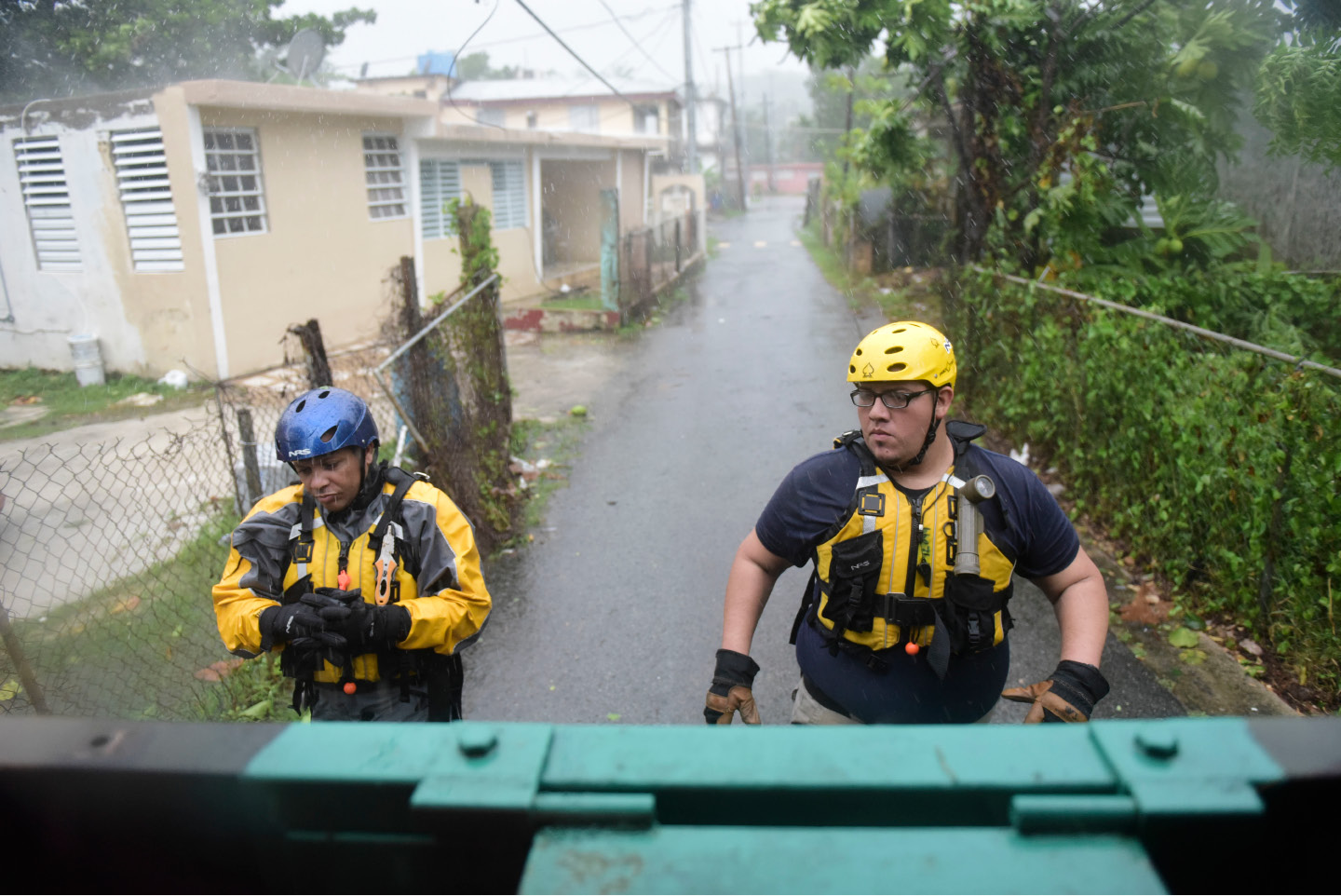 Julio Feliciano (left, and Adrian Colon, right, both rescue staff members from the Municipal Emergency Management Agency toured the streets of the Matelnillo community searching for citizens in distress during the passage of Hurricane Irma through the northeastern part of the island in Fajardo, Puerto Rico, Wednesday, Sept. 6, 2017. The US territory was first to declare a state of emergency las Monday, as the National Hurricane Center forecast that the storm would strike the Island Wednesday. (AP Photo/Carlos Giusti)