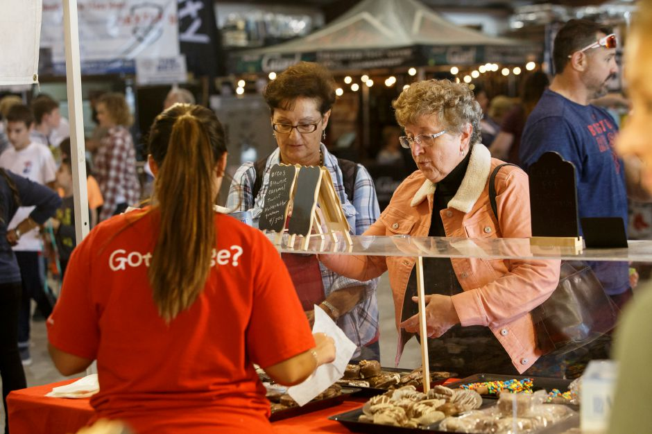 Olga Putka of Colchester right and Lynn Mutsey of Florida pick out some fudge treats Saturday during the 99th Durham Fair on the Durham Fairgrounds in Durham September 29, 2018 | Justin Weekes / Special to the Record-Journal