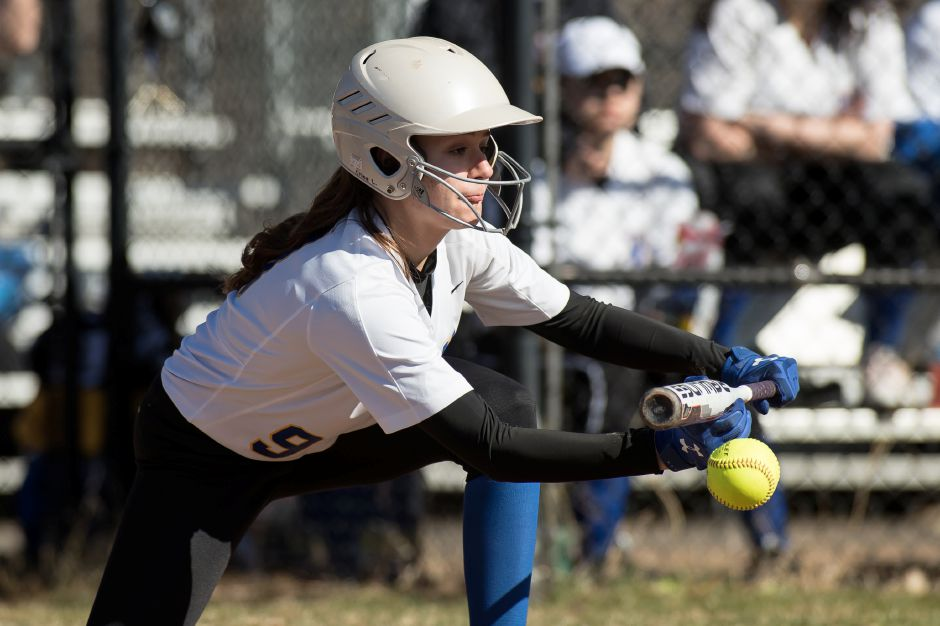 Chloe LaBissoniere drops down a bunt for a single during Wilcox Tech's 21-4 rout of Bullard-Havens on Wednesday in Meriden. Photos by Justin Weekes, special to the Record-Journal
