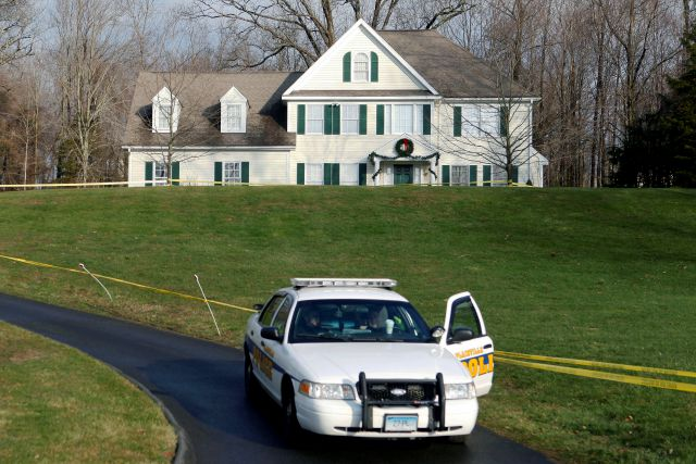 FILE - In this Dec. 18, 2012, file photo, a police cruiser sits in the driveway of the home of Nancy Lanza in Newtown, Conn., the Colonial-style house where she had lived with her son Adam Lanza. Some of the Sandy Hook Elementary School shooter