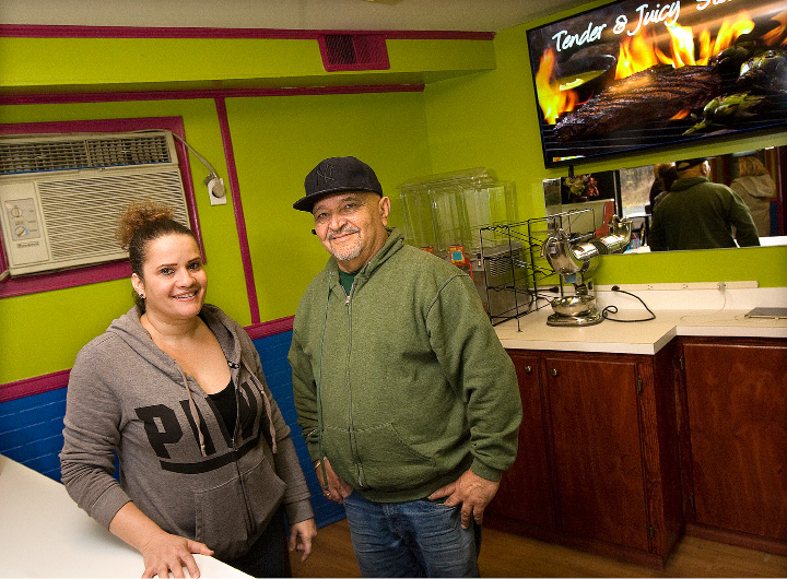 Lillian Matias, manager, and German Rosario, owner of Brasa Grill at 133 Hanover St. in Meriden. The restaurant opened Saturday.  | Dave Zajac, Record-Journal