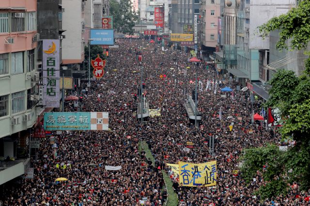 FILE - In this Sunday, June 16, 2019, file photo, tens of thousands of protesters march through the streets as they continue to protest against the unpopular extradition bill in Hong Kong. (AP Photo/Kin Cheung, File)