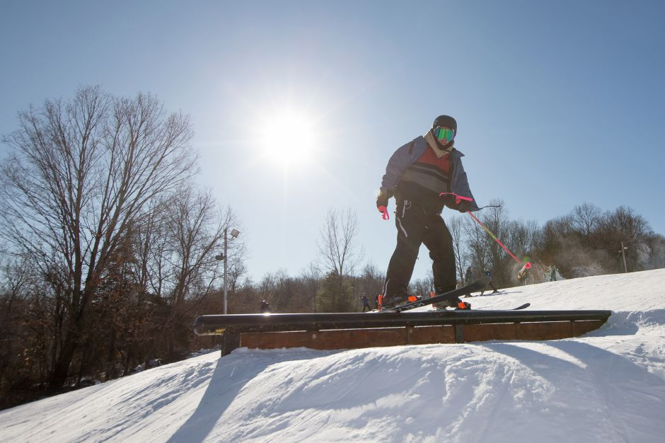 Anthony Palumbo, of Southington, hits a rail on the free style course Friday at Mount Southington Ski Area in Plantsville Dec. 29, 2017 | Justin Weekes / Special to the Record-Journal