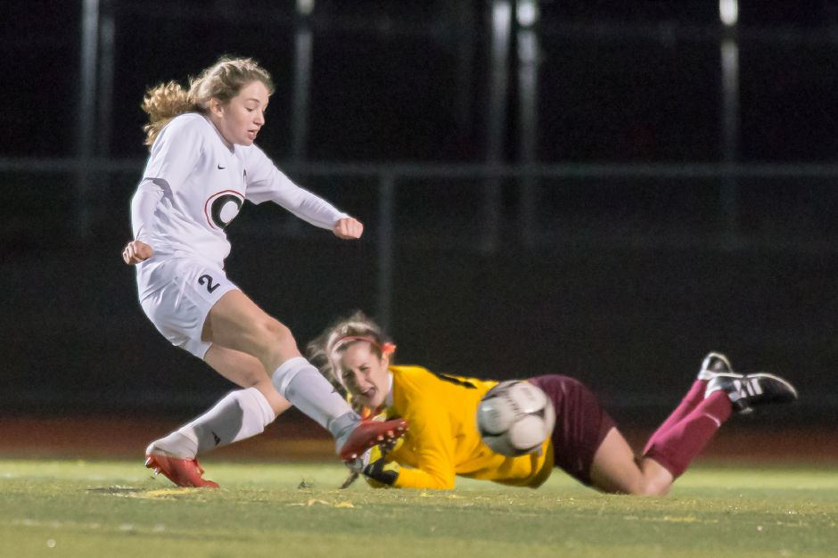 Cheshire's Lila McNamee scores her third goal of the match to open the second half on Sheehan's goalkeeper Elizabeth Arnold, right,  Monday at Riccitelli Field on the campus of Sheehan High School in Wallingford. Cheshire won 5-1.