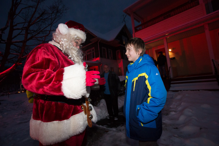 Andrew Doyle 10 of Meriden is greeted by Santa Saturday as the Spirit of Giving precession makes a stop at the Doyle