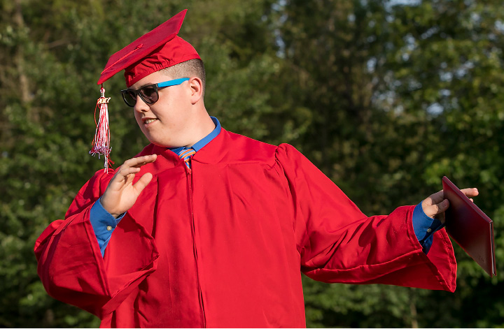 Graduate Benjamin Beaudoin strikes a pose after receiving his diploma during graduation ceremonies at Cheshire High School, Wednesday, June 14, 2017.  | Dave Zajac, Record-Journal